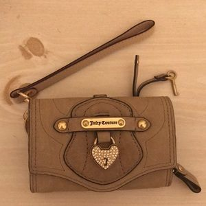 Brand new Juicy Couture wristlet/wallet.